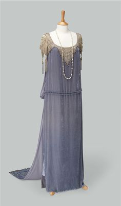 """1920s-style court ensemble worn by Elizabeth McGovern in the role of Cora Crawley, Countess of Grantham, sponsor for debutante Lady Rose MacClare, in the TV series """"Downton Abbey."""" Designed by Caroline McCall. Costume courtesy of Cosprop; jewellery courtesy of Sophie Millard Jewellery."""