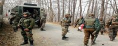 Troops conducting search operation at Handwara on Monday. -Excelsior Photo