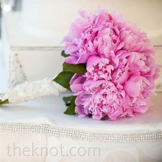 Pink peony bouquet wrapped in lace from the bride's mother's wedding dress. I'm definitely stealing this idea!