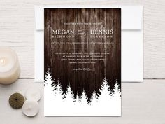winter wedding invitation with trees and a wood background