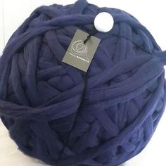 manmade but totally affordable for gigantic blankets.  super soft with a lovely sheen.  knit on 40mm needles or arm knit  5 metres per 100g.  100% acrylic