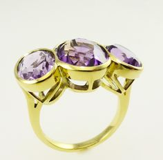 An amethyst dress ring set in 18 carat yellow gold.