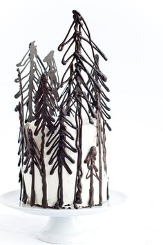 piped chocolate tree garnish on black forest gateau; from Desserts for Breakfast