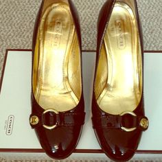 Coach patent leather pumps! Beautiful black patent pumps by Coach with gold hardware detail on toe. Gorgeous shoe! I wouldn't sell these if they fit me but are too small. Barely worn in excellent condition. Made in Italy and comes with original box. Coach Shoes Heels
