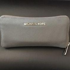 Michael Kors Wallet Grey leather Michael Kors wallet. Michael Kors Bags Wallets