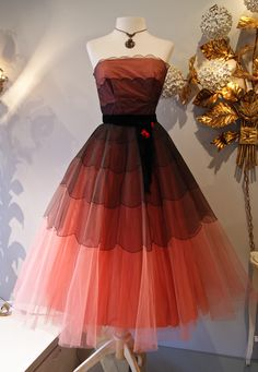 1950's Party dress. Such a pretty vintage dress! Sheer layers make a really fun effect, and the scalloping add to it to make it really look put together.