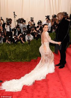Inspiration? However, some have pointed out that Kim's sheer gown looks suspiciously simil...