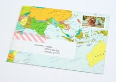 World Traveler Party: map envelopes with washi tape  {One Charming Party}