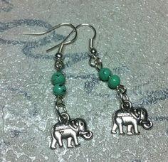 Handmade Tibet style elephant charm with turquoise bead