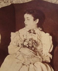 """Compare this Postmortem to all of the falsely labeled girls sitting in chairs.   She is propped ip and her hands are placed over the flowers, keeping them in place, but not """"holding"""" them.  And she looks, well, dead.  (Or at best, asleep)"""