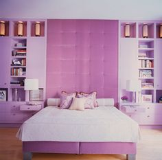 A very tall upholster headboard for a girl in love with purple.