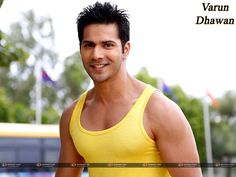 Bollywood Hero Varun Dhawan in Yellow Vest HD Pics