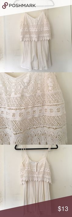 topshop ivory crochet lace romper sz 4 white/ivory/cream colored topshop romper sz 4 worn once. no stains/rips etc. note: straps are not adjustable. feel free to make offers! Topshop Shorts