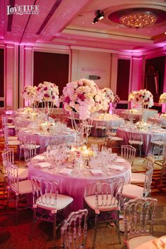 Mandarin Oriental DC wedding. Pink Lighting and lavish pink and white flower table settings. Photo by Love Life Images