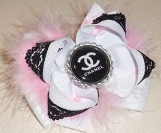 Chanel Inspired Couture double Stacked white withpink fur Boutique Hair Bow With black CC bottlecap, & black lace. $7.99, via Etsy.