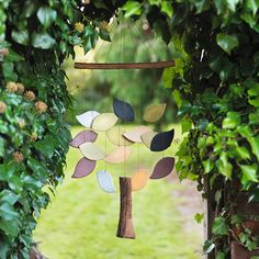 Aliba Mobile Wind Chime - Traidcraft - Natural Collection - A fair trade hanging wind chime in the shape of a tree with a trunk and leaf shapes, perfect for hanging in the garden. It is ethically made by a artisans for Allpa in Peru, who give employees advances, loans and design advice to help them become more financially secure with a stable income. #Handmade #India #FairTrade