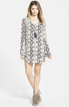 Free shipping and returns on Filtre Snake Print Bell Sleeve Shift Dress at Nordstrom.com. A snake print patterns a breezy, bell-sleeve shift dress finished with blue tasseled tie ends at the neckline.