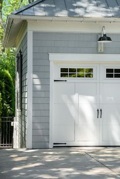 garage door trim provides great curb appeal for your exterior. Here are 10 garage door trim ideas for completing your house. Garage Door Lights, Garage Door Trim, Carriage Garage Doors, Garage Door Hardware, Garage Door Design, Garage Lighting, Barn Lighting, Exterior Garage Lights, Architecture Drawings