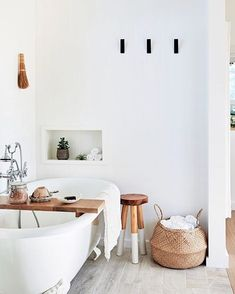 clawfoot tub // The bathroom tub is Randolph Morris; the dip-dyed stool is from Serena & Lily. Modern Boho Bathroom, Wood Bathroom, Bathroom Inspo, Beautiful Bathrooms, Small Bathroom, Natural Bathroom, Bathroom Ideas, Scandinavian Bathroom, Bathroom Remodeling