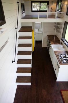 Texas Waterfront is a gorgeous tiny house built by Nomad Tiny Homes. This custom 28-foot tiny house is located along Lake Travis, near Austin, Texas. In the kitchen is a beautiful walnut herringbone butcher block counters, a 24″ farmhouse sink, and shaker style cabinets. Appliances include a retro style SMEG refrigerator, four burner propane cooktop, … Texas Waterfront by Nomad Tiny HomesRead More »