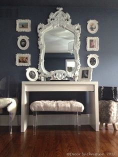 A stunning mirror creates the focal point in this dressing table vignette.