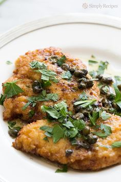 Chicken Piccata ~ Easy Chicken Piccata! Chicken breast cutlets, dredged in flour, browned, served with sauce of butter, lemon juice, capers, and stock or wine. ~ SimplyRecipes.com