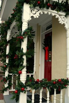 Beautifully decorated Christmas porch in berries and red ornaments. Christmas Porch, Noel Christmas, Outdoor Christmas Decorations, Country Christmas, Winter Christmas, All Things Christmas, Christmas Wreaths, Christmas Crafts, Holiday Decor
