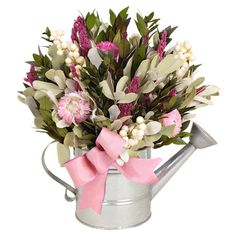 Faux floral and berry arrangement in a metallic watering can.  Product: Faux floral arrangementConstruction Material: Silicone, natural twig and metalColor: Multi Dimensions: 12 H x 10 W x 7.5 D Note: Avoid sunlight and humidityCleaning and Care: Wipe gently with a dry cloth