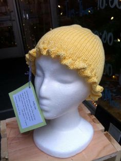 Frilly hat by Andrea Newell Greenfield! Sunshine yellow with a fun frill for the brim, this hat is sure to please little girls everywhere. Made from 100% cotton for easy care and comfort. (Size approx. 2 years) (Machine wash and dry) Get this wonderful piece for $25 today!