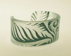Artist Heather Joy Puskarich's  Green Fern Cuff. made from recycled glass and photo resist. see more...  http://heatherjoyp.com/home.html