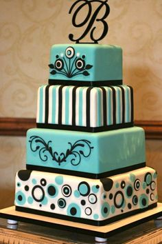black and turquoise cakes - The top two tiers