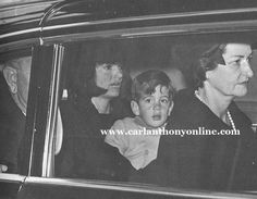 Two days after President Kennedy's assassination, Jacqueline Kennedy and her son ride to the U.S. Capitol where his body was laying in state, sharing a limousine with the new President and Mrs. Johnson.