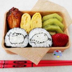 Japanese character bento with maki sushi and tamagoyaki.
