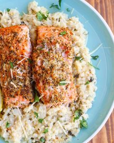 Crispy and delicious garlic butter salmon with a creamy Parmesan cauliflower rice is the perfect weeknight meal! Ready in only 15 minutes!