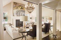 A chandelier by Solaria Lighting illuminates this elegant living room.