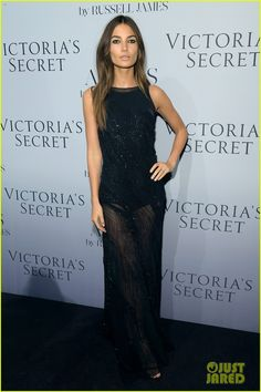 Lily Aldridge and Candice Swanepoel pose together on the red carpet at the Victoria's Secret hosted launch of photographer Russell James' new book