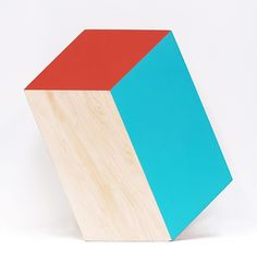 Shape Boards are equal parts functional and decorative. The blank side is a cutting board surface, and the painted side is decorative, painted (with non-toxic paint) to give the illusion of a 3D geometric shape. Shape Boards can either hang on your wall or rest on it's edge. We figured you might as well have something interesting to look at while your cutting board isn't in use. They're available in different shapes, sizes and types of wood.