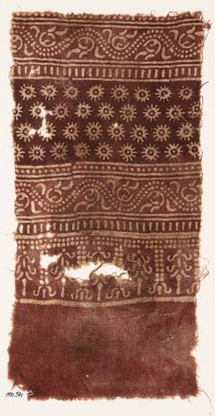 Textile fragment with bands of dotted vines, tendrils, rosettes, and stylized treesfront. 10th to 15th c Egypt