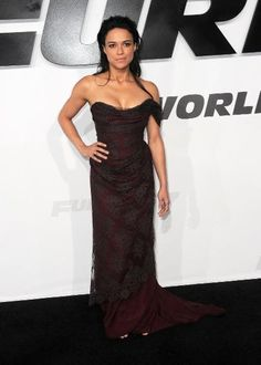 "Michelle Rodriguez in this wine colored gown is definitely a style departure for the actress — but one that should be repeated regularly. The strapless Vivenne Westwood dress is fitted, featuring the designer's signature corseted top, and the lace overlay adds some ""Downton Abbey""-inspired elegance."