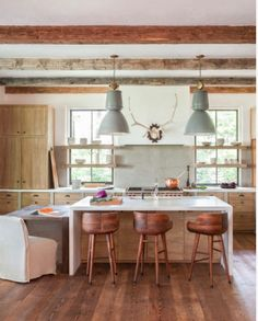 Rustic kitchen by D.