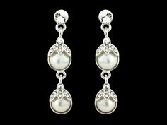 NEW STOCK  ORNATE PEARL DROP EARRINGS - IVORY - ONLY £12!  Pretty ornate earrings from our fabulous swarovski and cz collection. With ivory simulated pearls on a silver tone finish - measure approx 4.5cm long - perfect for brides or bridesmaids   http://www.vintageaddress.com/Ornate_Pearl_Drop_Earrings_-_Ivory/p1143724_8574839.aspx