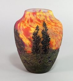 A Daum Nancy cameo glass landscape vase, c.1910, of baluster form, depicting a woodland sunset, engraved Daum Nancy with cross of Lorraine, approx 17.5cm high. - Price Estimate: £800 - £1200