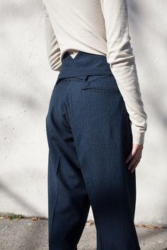 Wool-twill trousers in a relaxed silhouette with soft pleats at front and cross-back self-tie. Made in Japan. 100% Wool. Cult designer Hiroki Nakamura blends traditional Japanese craftsmanship with Am