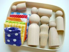 family pegs and sleeping bags - Peg dolls have a colored dot on the bottom of each to help match to the proper sized sleeping bag.