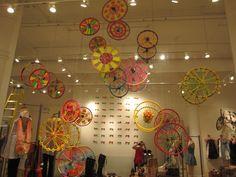 Creating a display using bicycle wheels Free People Blog, Free People Store, Bicycle Art, Visual Display, Collaborative Art, Store Displays, Art Club, Retail Design, Store Design