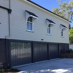 Mirrors under the slats mask a tripe car garage and give the illusion of a typical Queenslander which is usually open underneath