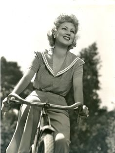 Ann Sothern on a bicycle, 1939