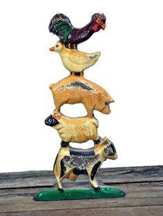 Cast Iron Doorstop Farm Animals. $46  http://www.etsy.com/listing/92958148/cast-iron-doorstop-farm-animals-cow