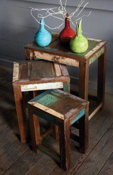 Made of reclaimed teak wood.  I like the splashes of color left behind.
