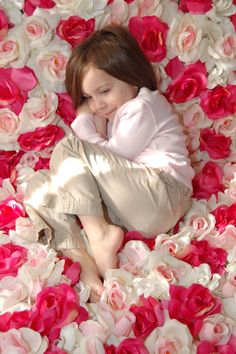"""Silk flowers sewn or hot glued onto fabric = the """"Flower Blanket"""" that is used for baby girl photos in a certain well-known studio photography chain."""